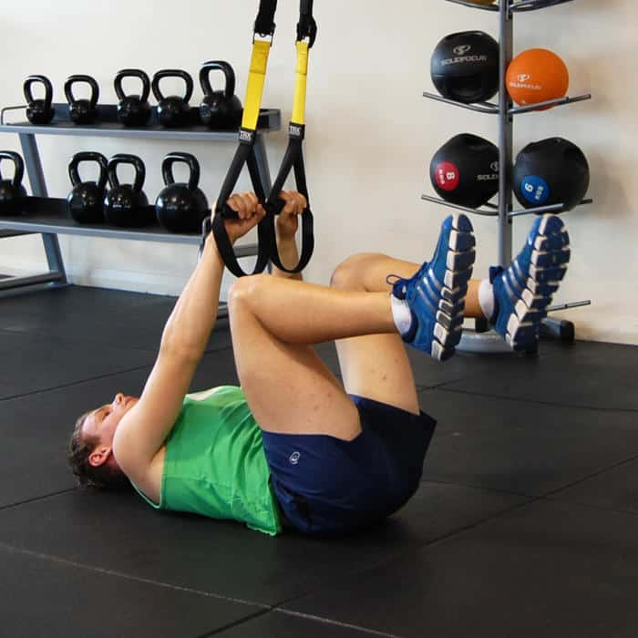 Man performing the TRX bent leg raise