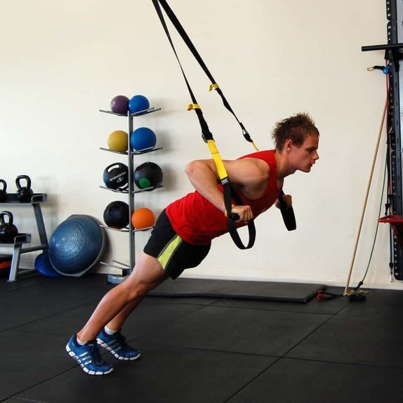 Man performing the TRX chest press