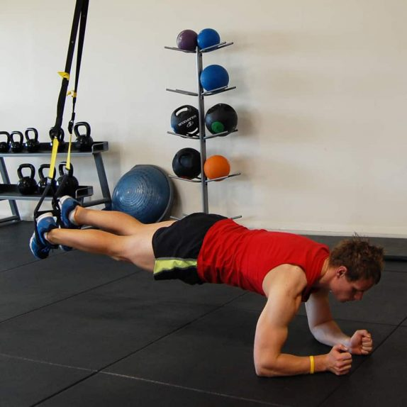 Man performing the TRX Plank