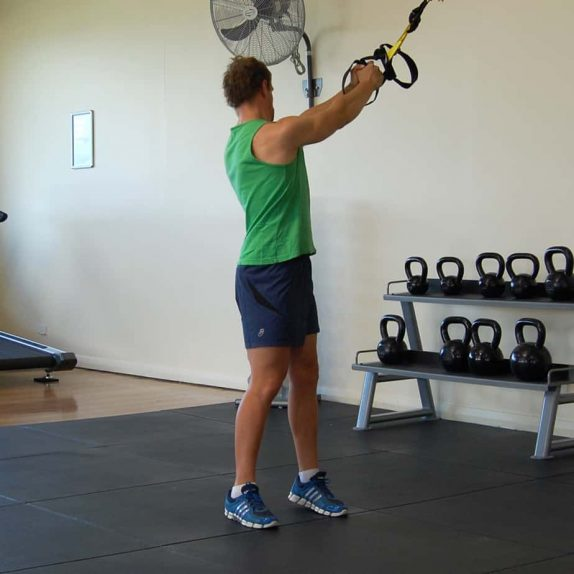 Man performing the TRX torso rotation